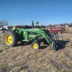 John Deere Tractor with Front Loader Hay Forks