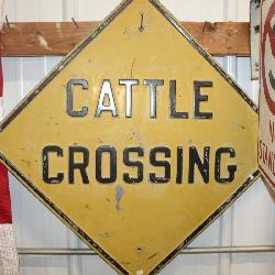 Lots of signs incl. Cattle Crossing