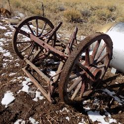 WOODEN WAGON WHEELS, CROCKS,AND OTHER ANTIQUES