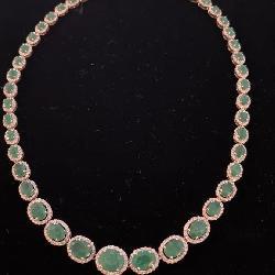 - 14K EMERALD AND DIAMOND NECKLACE;