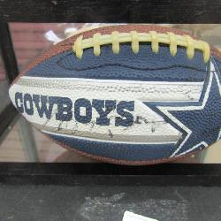 Signed Dallas Cowboy football in glass display case