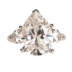 Lot 2092 Diamond, Platinum Ring with 18k Yellow Gold Guard. Estimate:  $80,000 / 120,000