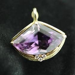 large 40+ carat amethyst diamond and gold pendant